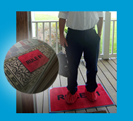 We use red rugs that we place at the homeowner's front door with Rule #1 on it signifying that our #1 rule is to respect the property (techs put on shoe protectors on it so they don't track anything in the house).