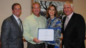 Scott and Sarah Kellam were presented an award on October 24th, 2012 acknowledging Kellam Mechanical's support for the Virginia Beach Clean Community Commission's mission to keep Virginia Beach beautiful. From the left - Councilmen Bill DeSteph, Scott Kellam, Sarah Kellam and Councilmember Bob Dyer
