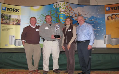 Scott and Sarah Kellam were presented the 2010 Presidents Award for outstanding commitment in loyalty and business partnership.